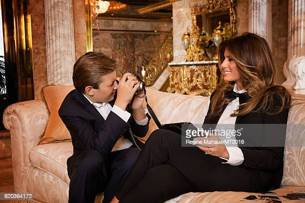 Barron Trump is using the new FUJIFILM instax mini 90 as he and Melania Trump are photographed at Trump Tower on January 6 2016 in New York City