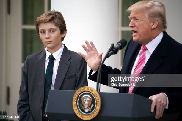 Barron Trump joins his father US President Donald Trump as he makes remarks before pardoning the National Thanksgiving Turkey with National Turkey...