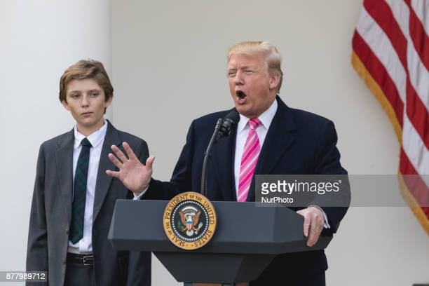 Barron Trump stands next to his Dad President Donald Trump as he speaks at the National Thanksgiving Turkey Pardoning Ceremony in the Rose Garden of...