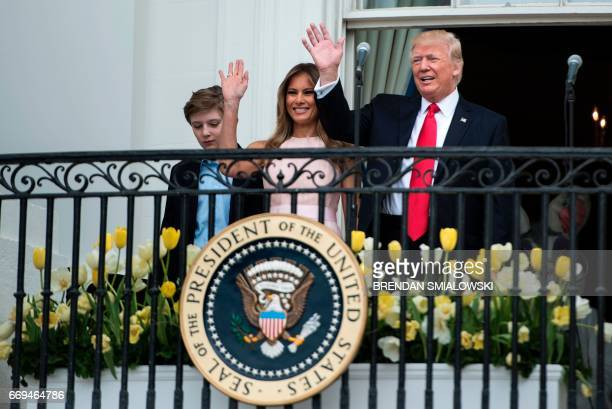 Barron Trump US First Lady Melania Trump and US President Donald Trump arrive for the Easter Egg Roll on the South Lawn of the White House April 17...