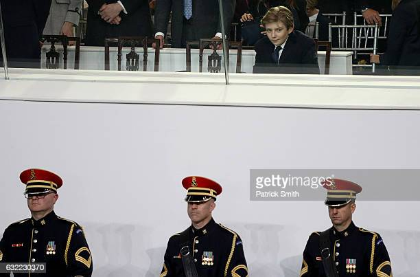 Barron Trump watches the Inaugural Parade from the main reviewing stand in front of the White House on January 20 2017 in Washington DC Donald J...