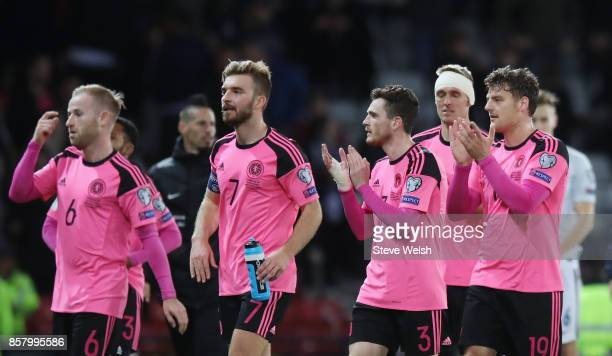 Barry Bannan James Morrison Andrew Robertson and Chris Martin of Scotland celebrate victory after the FIFA 2018 World Cup Group F Qualifier between...