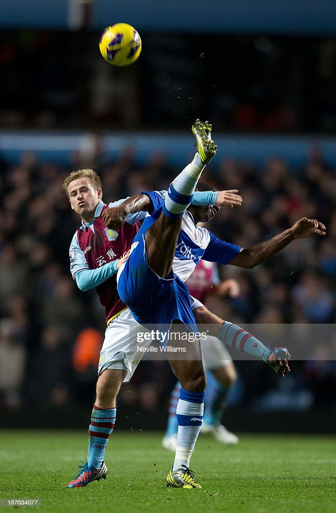 <a gi-track='captionPersonalityLinkClicked' href=/galleries/search?phrase=Barry+Bannan&family=editorial&specificpeople=5449430 ng-click='$event.stopPropagation()'>Barry Bannan</a> of Aston Villa challenged by <a gi-track='captionPersonalityLinkClicked' href=/galleries/search?phrase=Mikele+Leigertwood&family=editorial&specificpeople=224769 ng-click='$event.stopPropagation()'>Mikele Leigertwood</a> of Reading during the Barclays Premier League match between Aston Villa and Reading at Villa Park on November 27, 2012 in Birmingham, England.