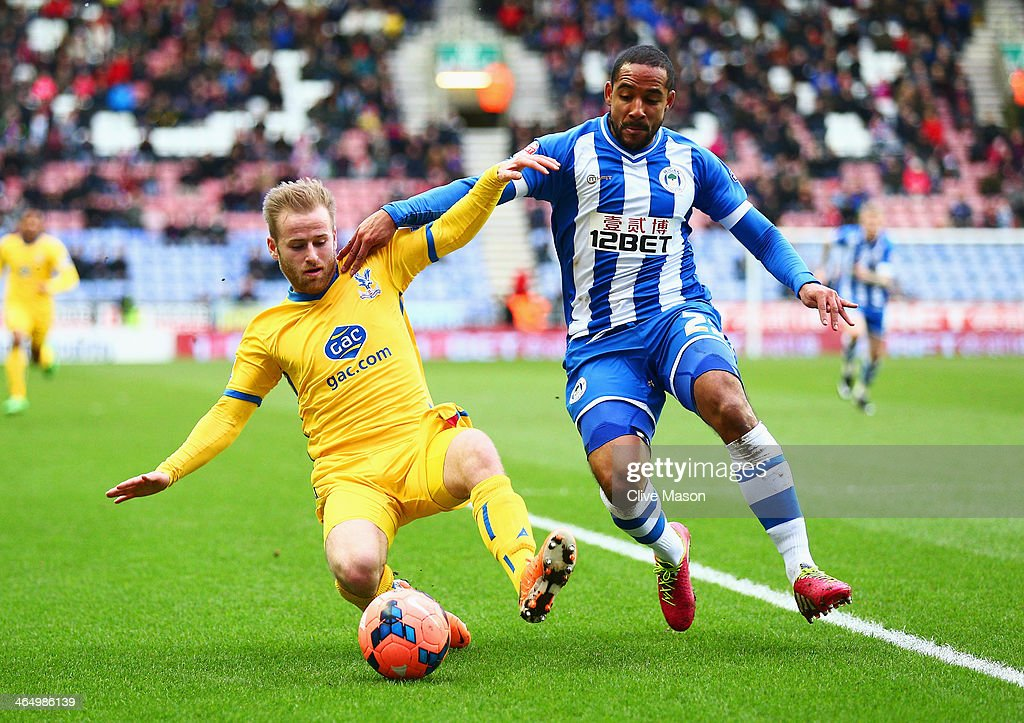 <a gi-track='captionPersonalityLinkClicked' href=/galleries/search?phrase=Barry+Bannan&family=editorial&specificpeople=5449430 ng-click='$event.stopPropagation()'>Barry Bannan</a> of Crystal Palace is challenged by <a gi-track='captionPersonalityLinkClicked' href=/galleries/search?phrase=Jean+Beausejour&family=editorial&specificpeople=4451501 ng-click='$event.stopPropagation()'>Jean Beausejour</a> of Wigan Athletic during the Budweiser FA Cup fourth round match between Wigan Athletic and Crystal Palace at DW Stadium on January 25, 2014 in Wigan, England.