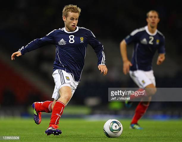 Barry Bannan of Scotland in action during the UEFA EURO 2012 Group I qualifying match between Scotland and Lithuania at Hampden Park on September 6...