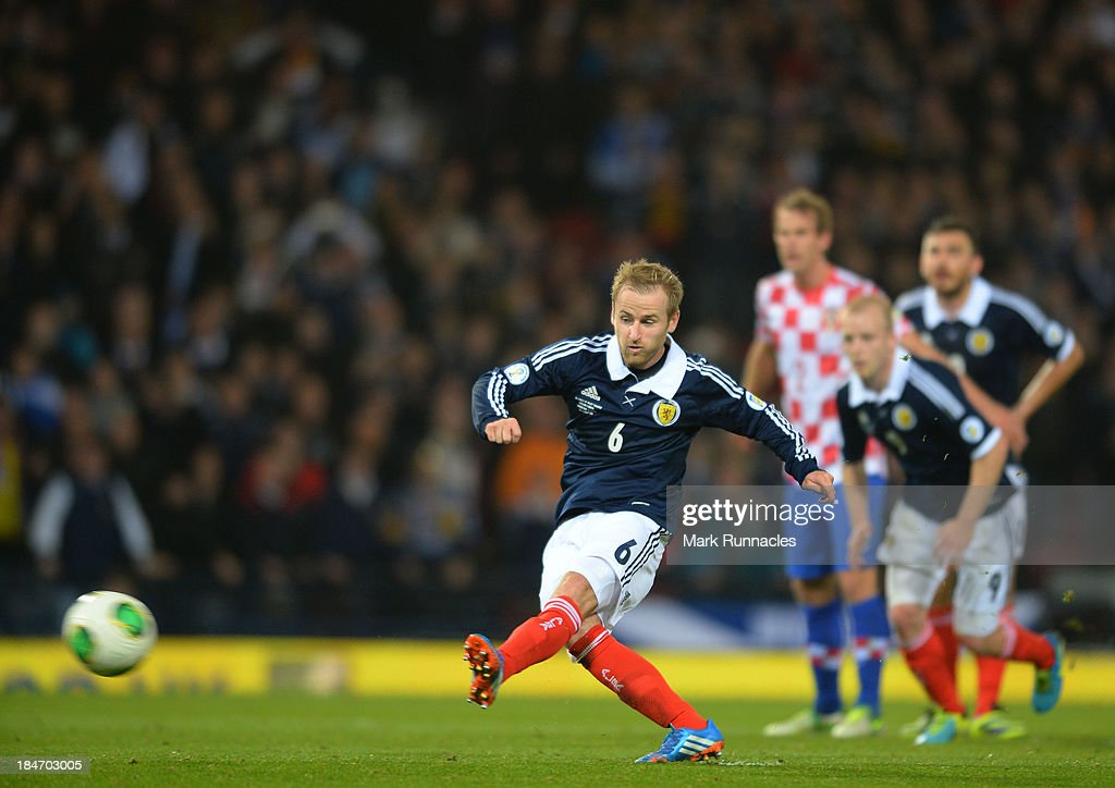 <a gi-track='captionPersonalityLinkClicked' href=/galleries/search?phrase=Barry+Bannan&family=editorial&specificpeople=5449430 ng-click='$event.stopPropagation()'>Barry Bannan</a> of Scotland takes and misses a penalty during the FIFA 2014 World Cup Qualifying Group A match between Scotland and Croatia at Hampden Park on October 15, 2013.