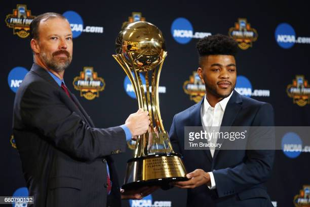 Barry Bedlan Deputy Director of AP Sports Products at The Associated Press presents Frank Mason III of the Kansas Jayhawks with the Associated Press...