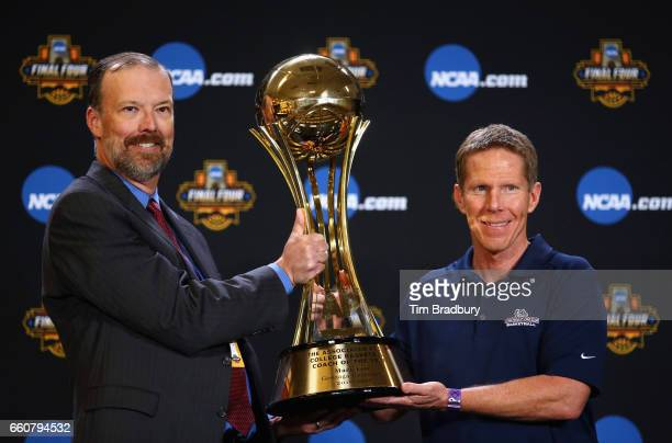 Barry Bedlan Deputy Director of AP Sports Products at The Associated Press presents head coach Mark Few of the Gonzaga Bulldogs with the Associated...