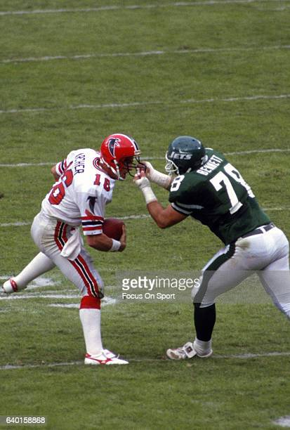 Barry Bennett of the New York Jets grabs David Archer of the Atlanta Falcons by the face mask during an NFL football game November 9 1986 at...