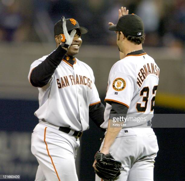 Barry Bonds and Dustin Hermanson of the San Francisco Giants celebrate 41 victory over the San Diego Padres at Petco Park in San Diego Calif on...
