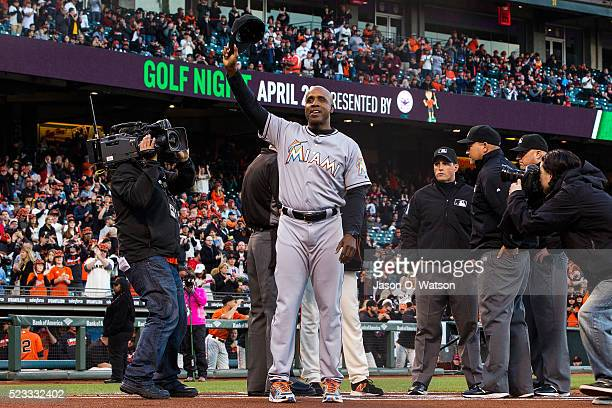 Barry Bonds of the Miami Marlins waves his cap after presenting a lineup card before the game against the San Francisco Giants at ATT Park on April...
