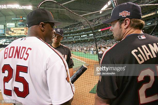 Barry Bonds of the National League team talks with Alex Rodriguez and Jason Giambi of the American League team before the Major League Baseball...