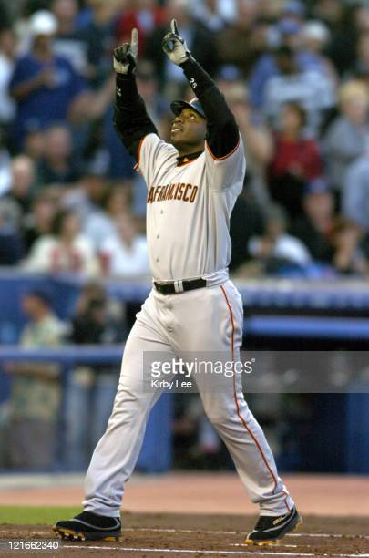 Barry Bonds of the San Francisco Giants points skyward after hitting his 678th career home run and 20th of the season on a threerun blast in the...