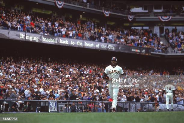 Barry Bonds of the San Francisco Giants runs to home plate after a home run against the Arizona Diamondbacks on April 15 2000 at Pac Bell Park in San...