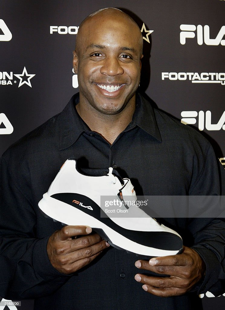 Barry Bonds shows off his new Fila signature cross-trainer shoe at a South Side store July 15, 2003 in Chicago, Illinois. Bonds introduced the shoe prior to his appearance in baseball's 74th All-Star Game.