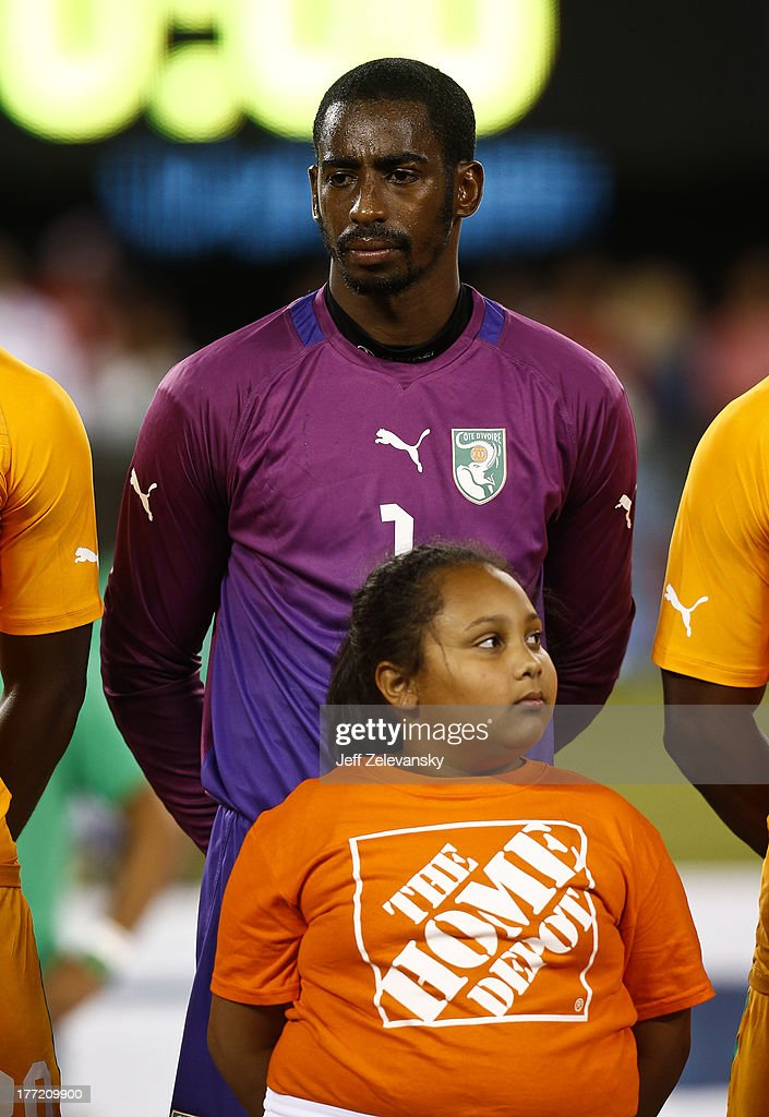 Barry Boubacar #1 of Ivory Coast stands for anthem before their match against Mexico at MetLife Stadium on August 14, 2013 in East Rutherford, New Jersey.