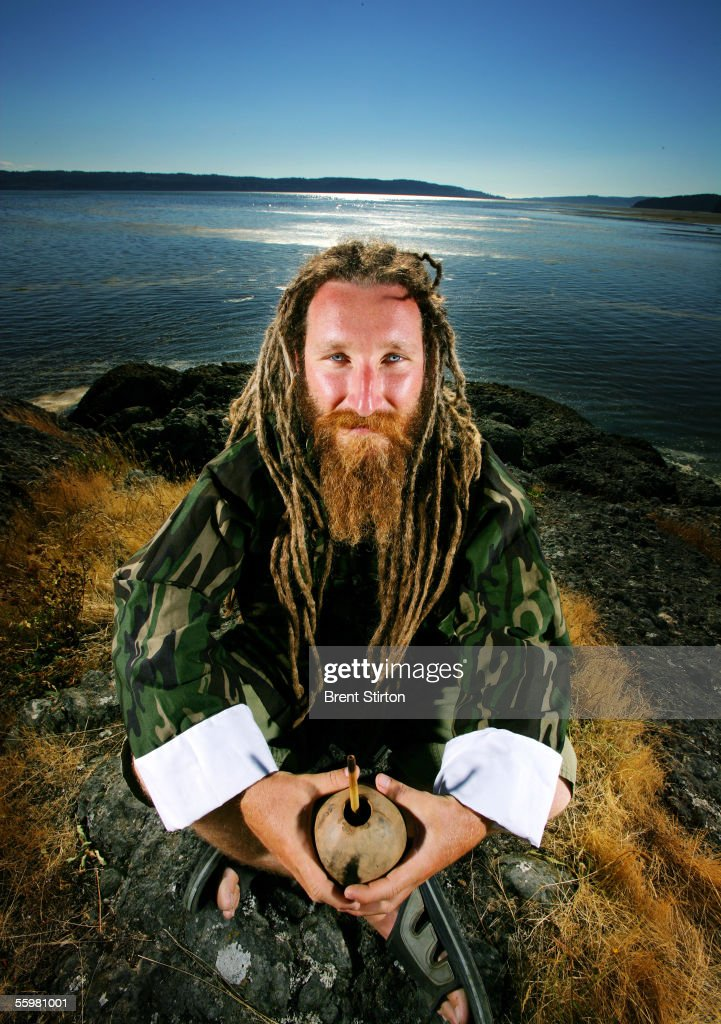 Barry Boullon, Rastaman, tea expert and logistics man for the 'Outstanding In The Field,' farm dinner team sits on a beach August 6, 2005 in Seattle, Washington. The team, under the leadership of artist/chef Jim Denevan, hosts organic farm dinners in esoteric locations across America and into Canada.
