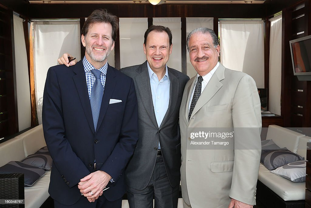 Barry Chamberlain, Armando Nunez and Joe Lucas are seen at the CBS Television Distribution cabana during NATPE at Fontainebleau Miami Beach on January 29, 2013 in Miami Beach, Florida.