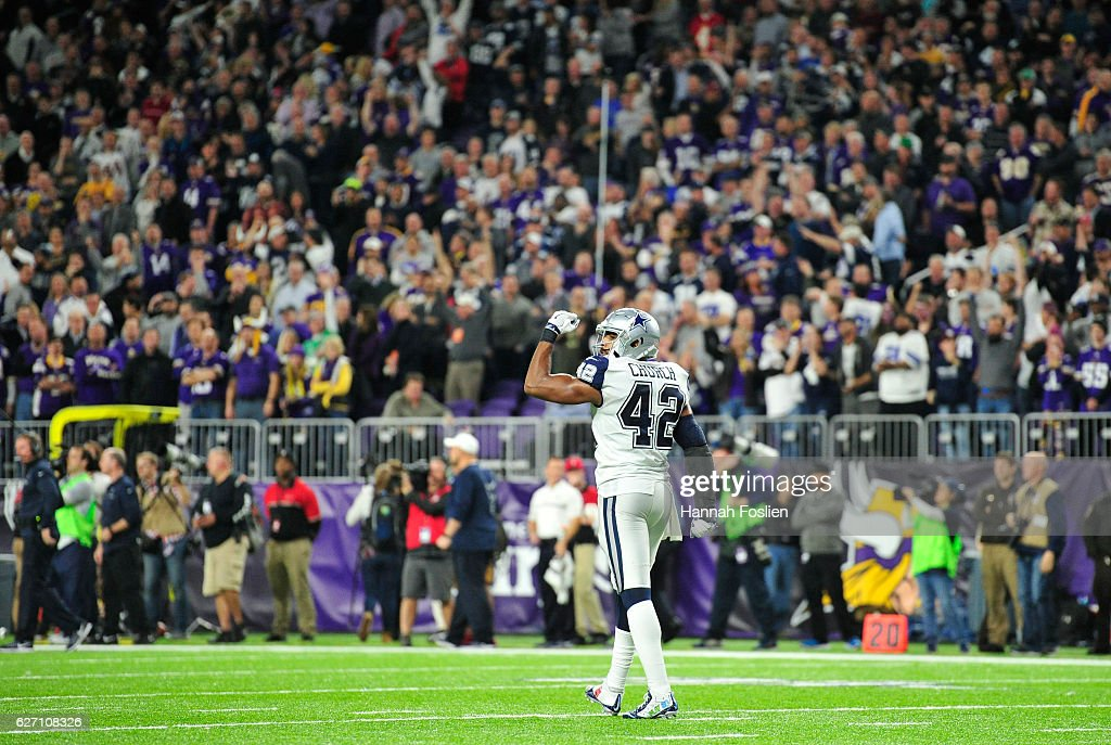 Barry Church #42 of the Dallas Cowboys walks off the field with a fist raised after the Cowboys forced an errant throw on a two point conversion attempt in the fourth quarter of the game against the Minnesota Vikings on December 1, 2016 at US Bank Stadium in Minneapolis, Minnesota. The Cowboys defeated the Vikings 17-15.