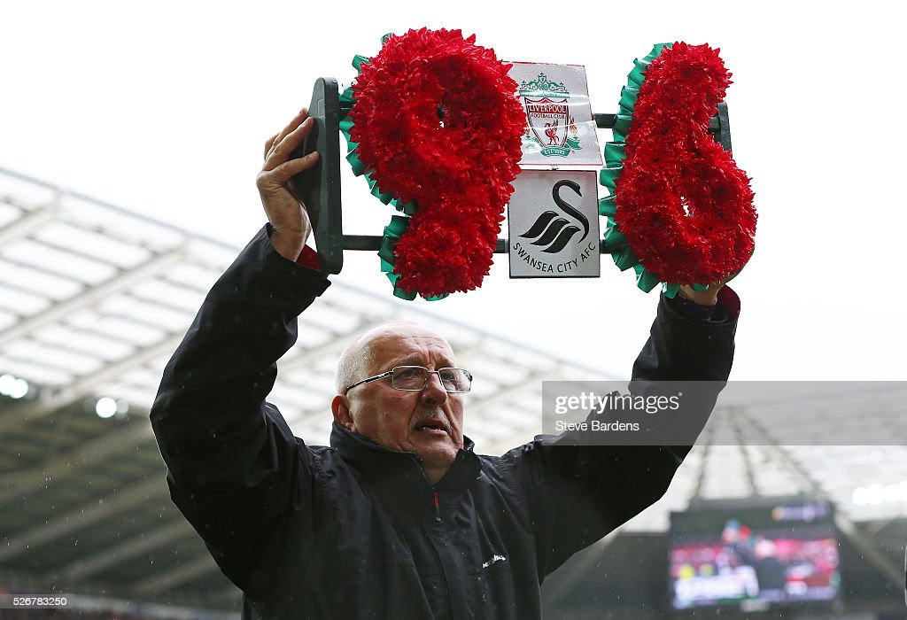 A wreath is carried as the team's remember the 96 victims of the Hillsborough disaster during the Barclays Premier League match between Swansea City and Liverpool at The Liberty Stadium on May 1, 2016 in Swansea, Wales.