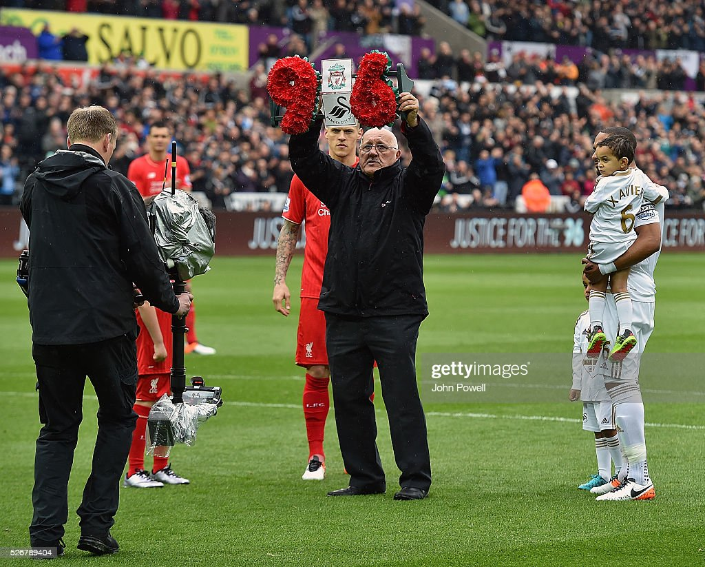 Barry Devonside, father of Hillsborough victim Christopher Devonside carries a wreath as the teams remember the 96 victims of the Hillsborough disaster during a Premier League match between Swansea City and Liverpool at the Liberty Stadium on May 01, 2016 in Swansea, Wales.