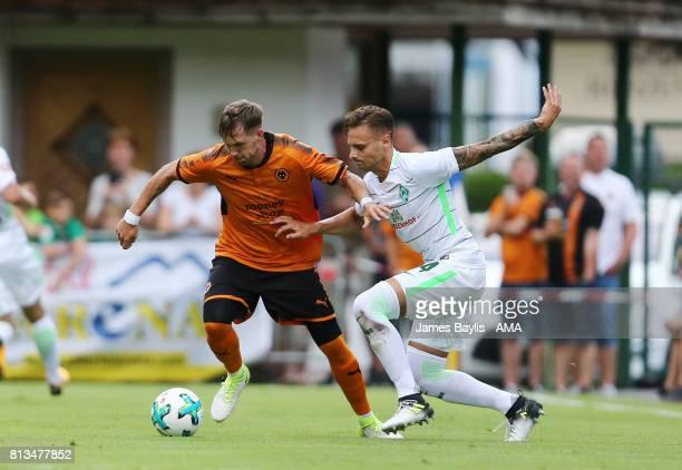 Barry Douglas of Wolverhampton Wanderers and Robert Bauer of Werder Bremen during the preseason friendly between Werder Bremen and Wolverhampton...