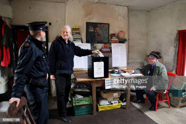 Barry Edgar Pilcher an Inishfree islander casts his vote on the Lisbon treaty in his living room which has become a makeshift polling station for the...