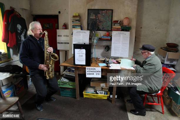 Barry Edgar Pilcher an Inishfree islander plays his saxophone after casting his vote on the Lisbon treaty in his living room which has become a...