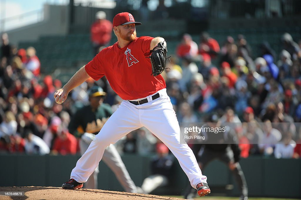 Barry Enright #45 of the Los Angeles Angels of Anaheim pitches during the game against the Oakland Athletics on February 24, 2013 at Tempe Diablo Stadium in Tempe, Arizona. The Athletics defeated the Angels 7-5.