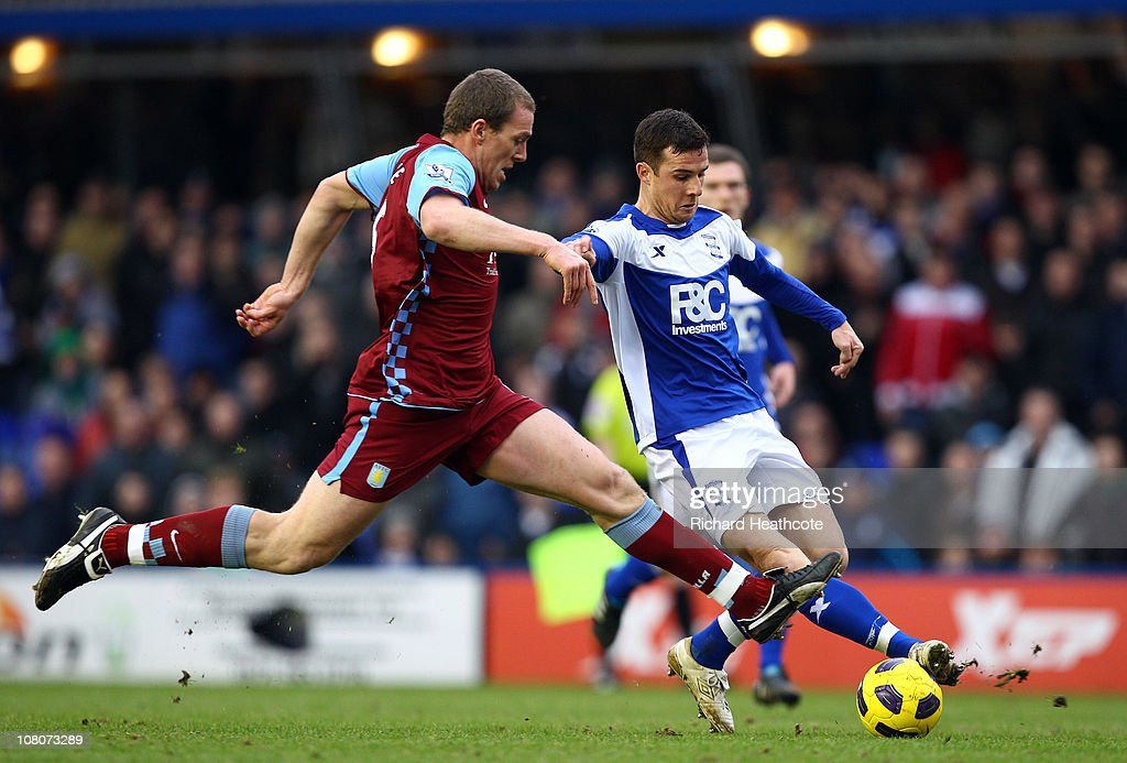 Barry Ferguson of Birmingham is tackled by Richard Dunne of Villa during the Barclays Premier League match between Birmingham City and Aston Villa at...
