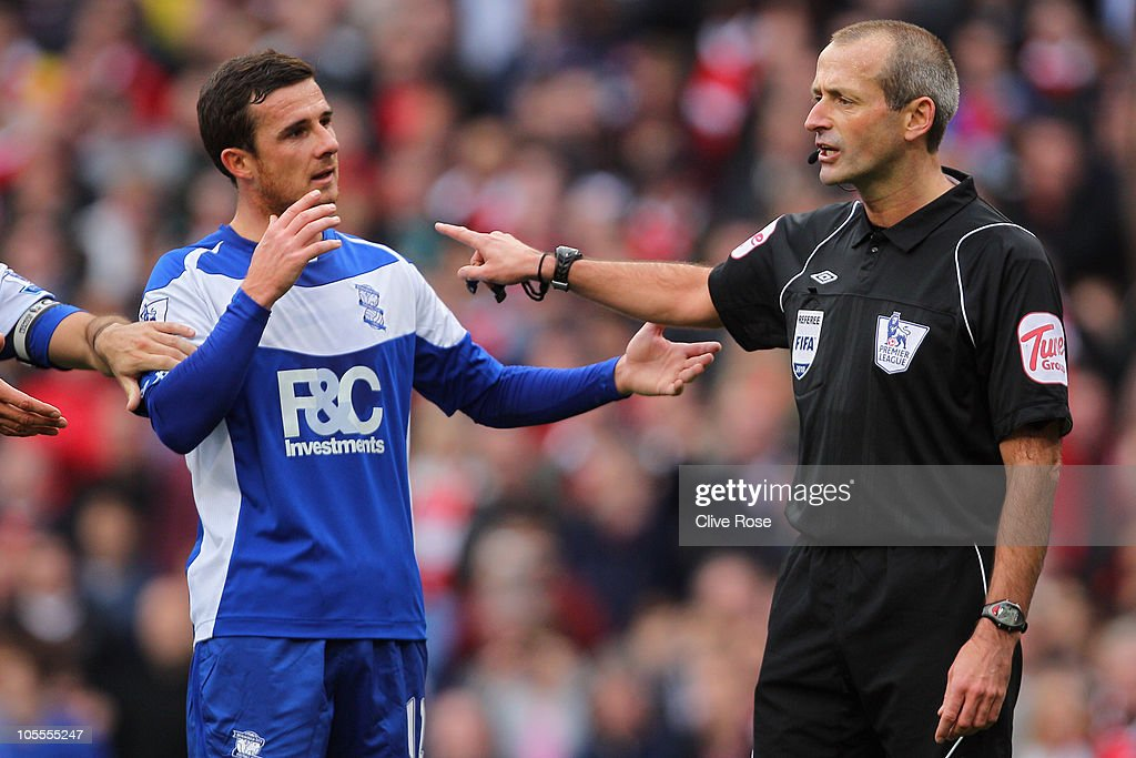 Barry Ferguson of Birmingham protests to referee Martin Atkinson after he awards a penalty to Arsenal during the Barclays Premier League match...