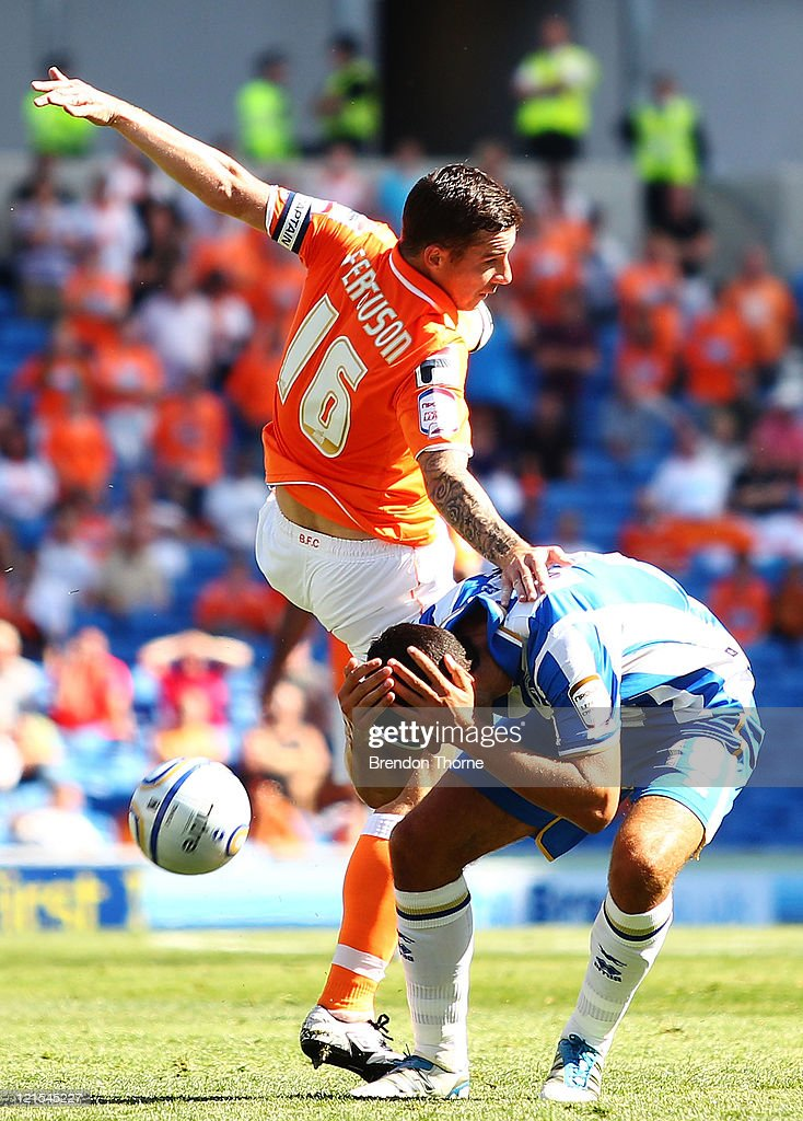 Barry Ferguson of Blackpool competes with Gary Dicker of Brighton Hove Albion during the npower Championship match between Brighton Hove Albion and...