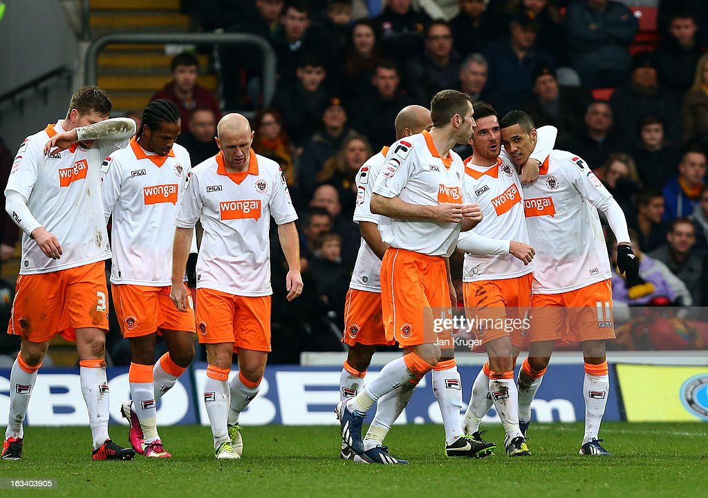 <a gi-track='captionPersonalityLinkClicked' href=/galleries/search?phrase=Barry+Ferguson&family=editorial&specificpeople=214188 ng-click='$event.stopPropagation()'>Barry Ferguson</a> of Blackpool embraces Thomas Ince after equalizing during the npower Champions match between Watford and Blackpool at Vicarage Road on March 9, 2013 in Watford, England.