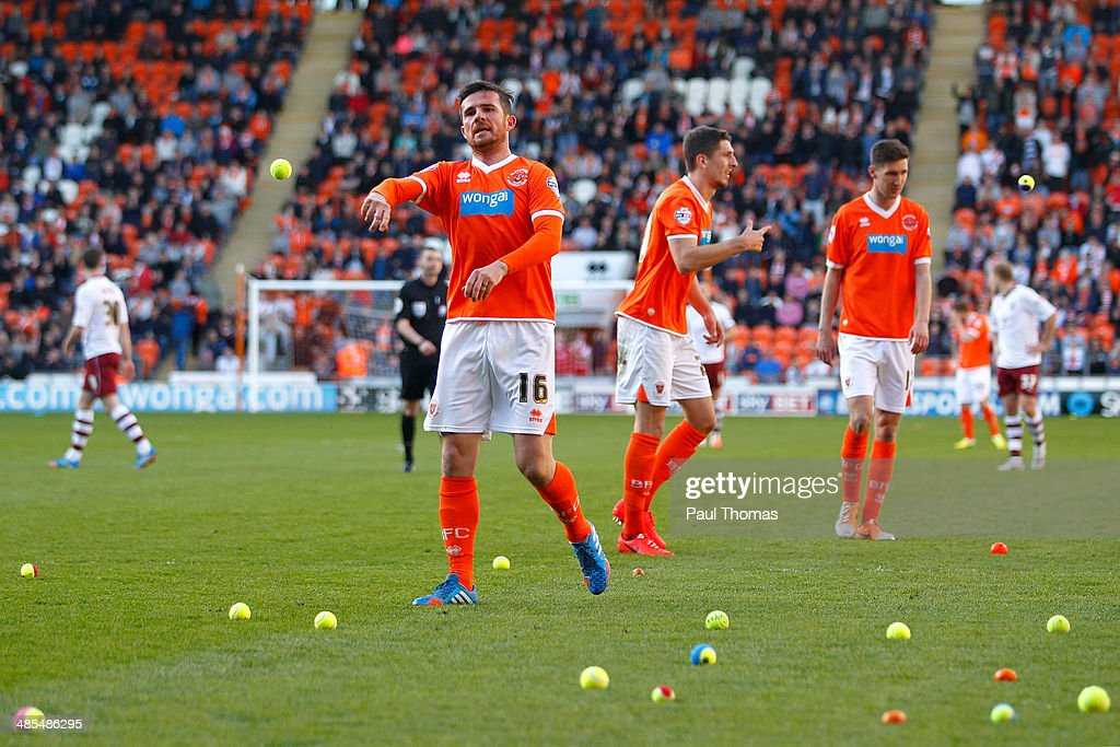 Barry Ferguson of Blackpool throws tennis balls off the pitch during the Sky Bet Championship match between Blackpool and Burnley at Bloomfield Road...
