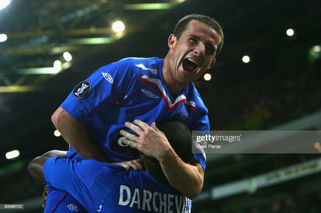Barry Ferguson of Rangers celebrates with JeanClaude Darcheville of Rangers after he scored his teams first goal during the UEFA Cup Quarter Final...