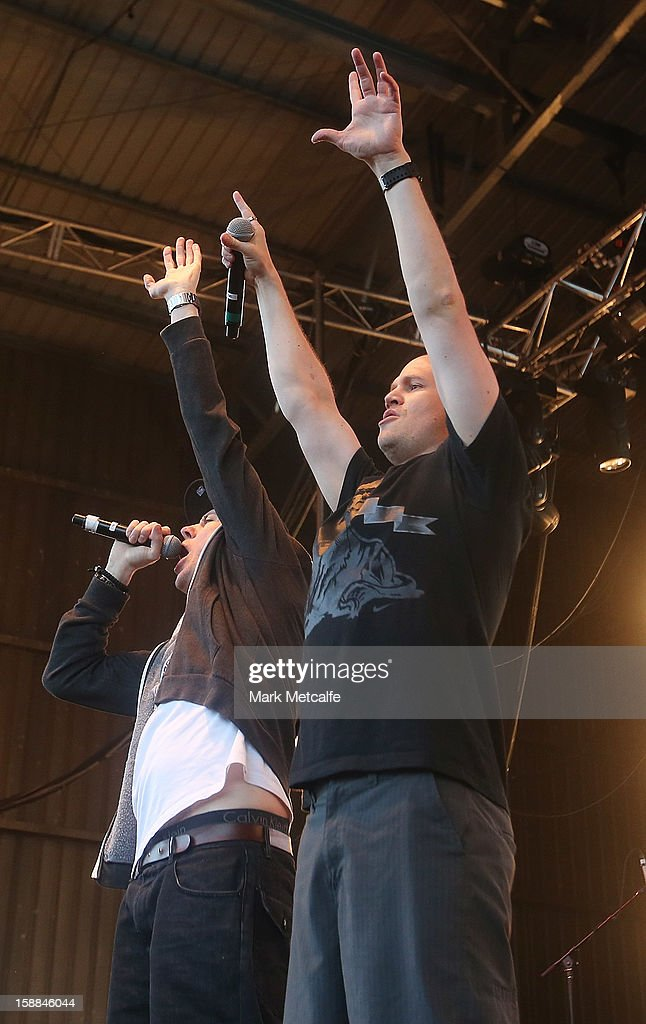 Barry Francis and Matt Lambert of the Hilltop Hoods performs live on stage at The Falls Music and Arts Festival on December 31, 2012 in Lorne, Australia.