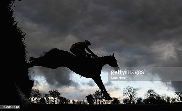Barry Geraghty and Master of the Hall jump the last in the gloom to win the Huntingdon Novices' Chase at Huntingdon Racecourse on January 26 2011 in...