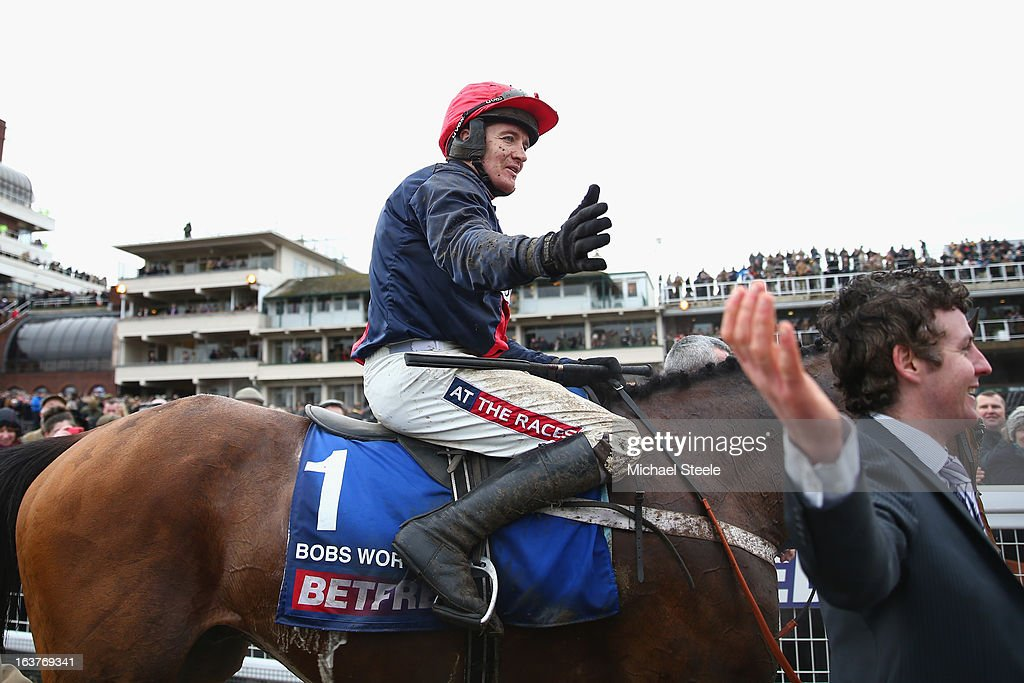 <a gi-track='captionPersonalityLinkClicked' href=/galleries/search?phrase=Barry+Geraghty&family=editorial&specificpeople=198943 ng-click='$event.stopPropagation()'>Barry Geraghty</a> on board Bobs Worth celebrates victory in the Cheltenham Gold Cup during Gold Cup day at Cheltenham Racecourse on March 15, 2013 in Cheltenham, England.