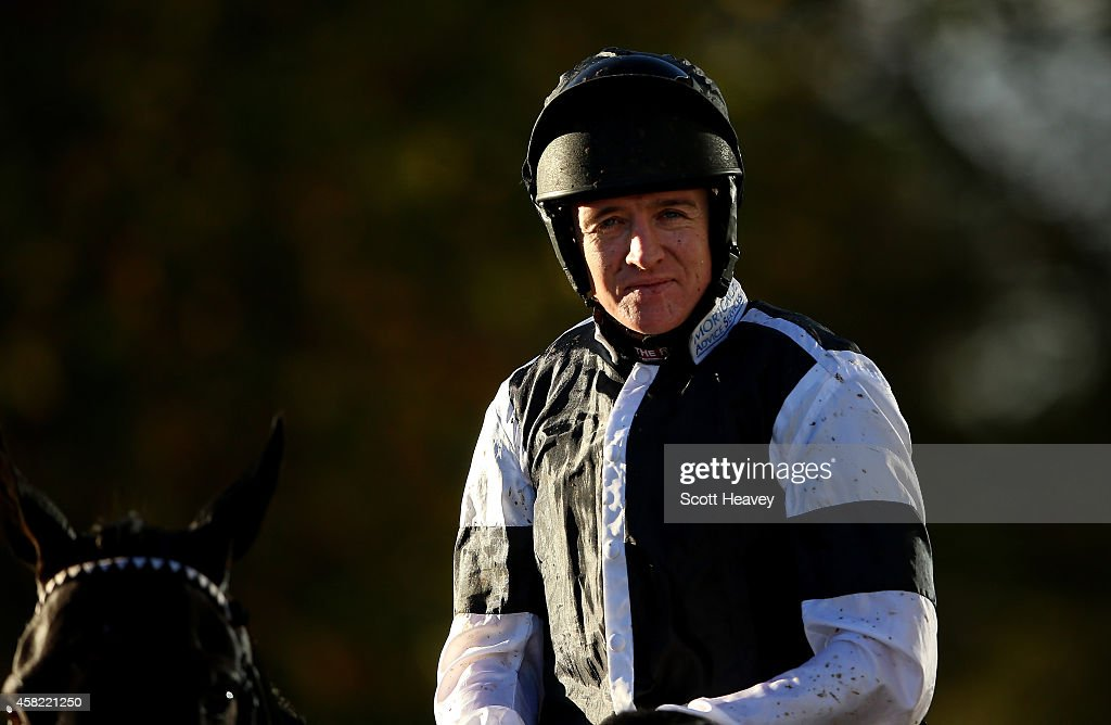 Barry Geraghty on Sign of Victory after winning The William Handicap Hurdle at Ascot Racecourse on November 1, 2014 in Ascot, England.