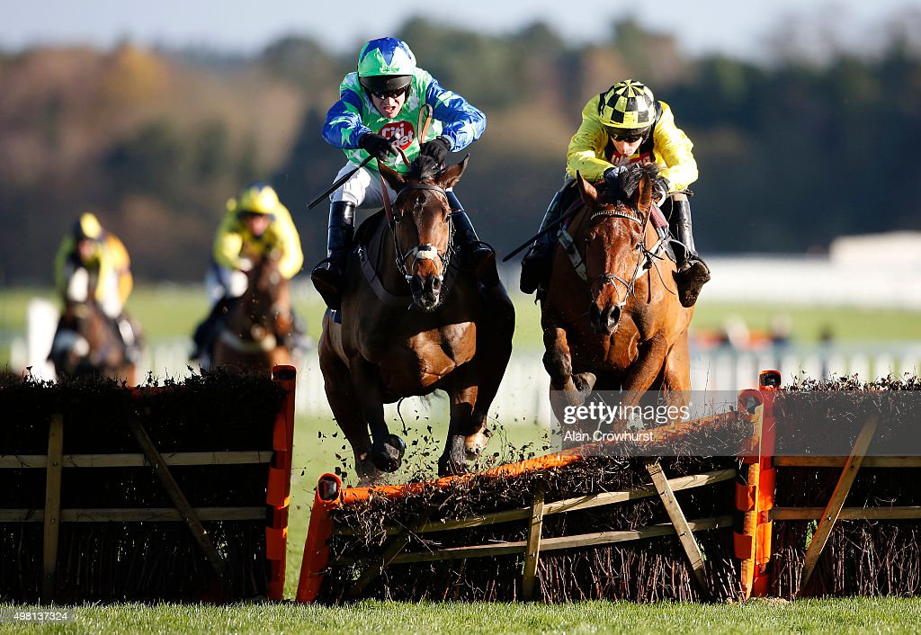 Barry Geraghty riding American (C, blue/green) clear the last to win The Mitie Events & Leisure Novices' Hurdle Race at Ascot racecourse on November 21, 2015 in Ascot, England.