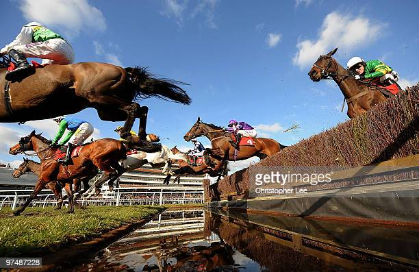 Barry Geraghty riding Big Fella Thanks jumps the water fence and goes on to win The Raymond Mould Supporting Greatwood Gold Cup Handicap Steeple...