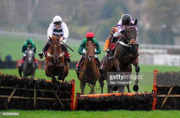 Barry Geraghty riding Bivouac clears the last to win The McMillan cancer Juvenile Hurdle Race at Sandown racecourse on December 05 2014 in Esher...
