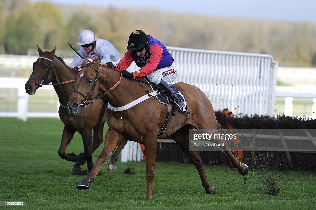 Barry Geraghty riding Close Touch (R) clear the last to win The Felix Rosenstiel's Widow & Son Introductory Hurdle Race at Ascot racecourse on November 23, 2012 in Ascot, England.