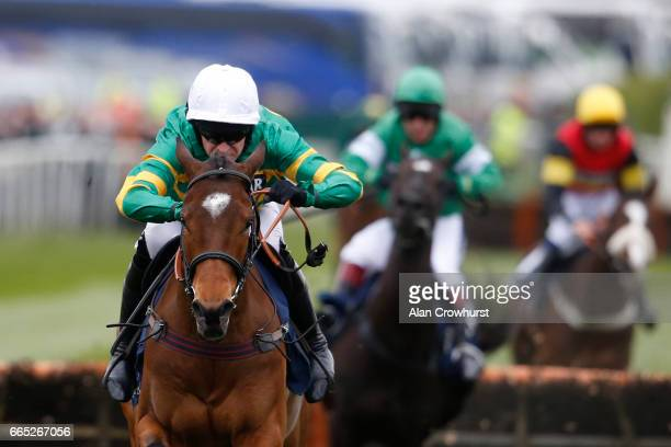 Barry Geraghty riding Defi Du Seuil clear the last to win The Doom Bar Anniversary 4YO Juvenile Hurdle Race at Aintree Racecourse on April 6 2017 in...