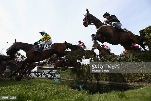 Barry Geraghty riding Eastlake clears the water jump on his way to victory in the Crabbie's Topham Steeple Chase at Aintree Racecourse on April 8...