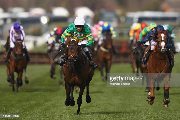 Barry Geraghty riding Eastlake on his way to victory from Tom Cannon riding Fairy Rath in the Crabbie's Topham Steeple Chase at Aintree Racecourse on...