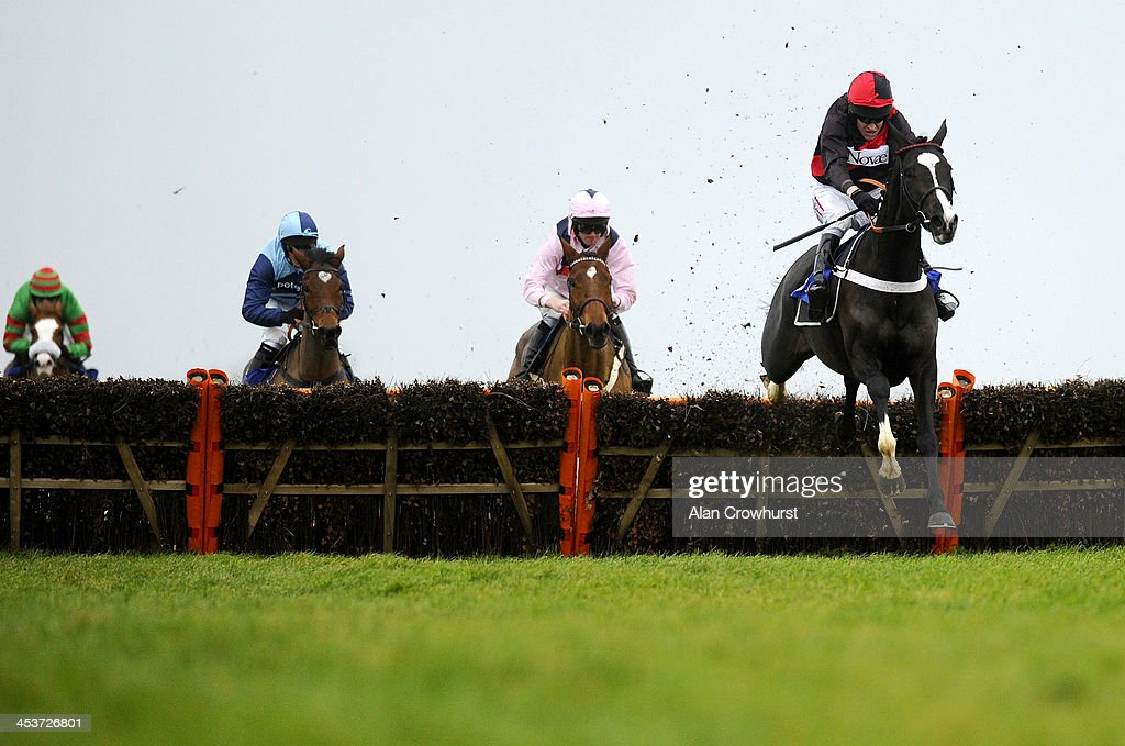 Barry Geraghty riding Mayfair Music clears the last to win The New Racing UK Anywhere Available Now Mares' Maiden Hurdle Race at Wincanton racecourse on December 05, 2013 in Wincanton, England.