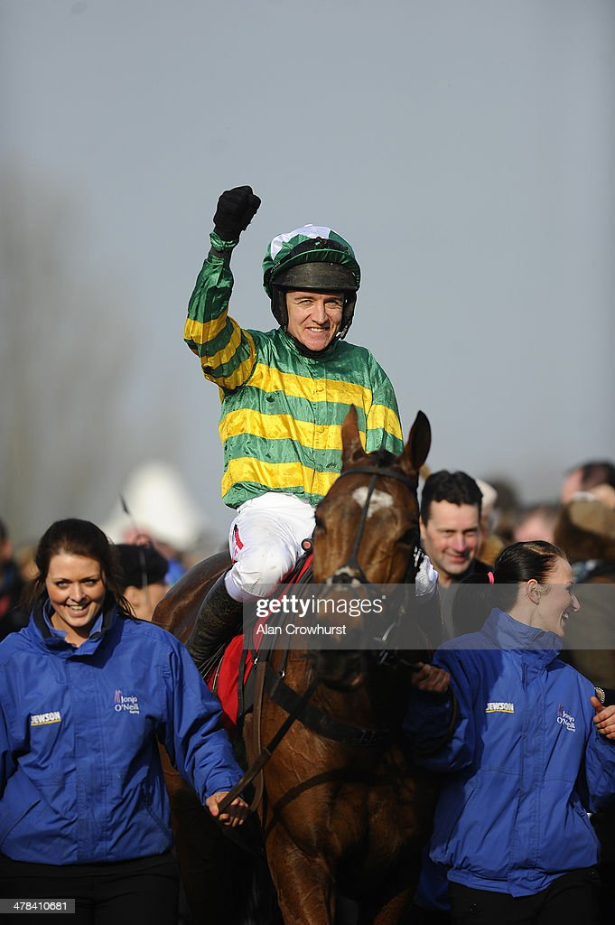 <a gi-track='captionPersonalityLinkClicked' href=/galleries/search?phrase=Barry+Geraghty&family=editorial&specificpeople=198943 ng-click='$event.stopPropagation()'>Barry Geraghty</a> riding More Of That celebrates after winning The Ladbrokes World Hurdle Race on St Patrick's Thursday during the Cheltenham Festival at Cheltenham racecourse on March 13, 2014 in Cheltenham, England.
