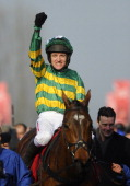 Barry Geraghty riding More Of That celebrates after winning The Ladbrokes World Hurdle Race on St Patrick's Thursday during the Cheltenham Festival...