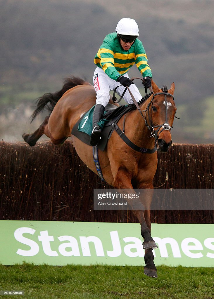 Barry Geraghty riding More Of That clear the last to win The Raymond Mould Memorial Noovices' Steeple Chase at Cheltenham racecourse on December 12, 2015 in Cheltenham, England.
